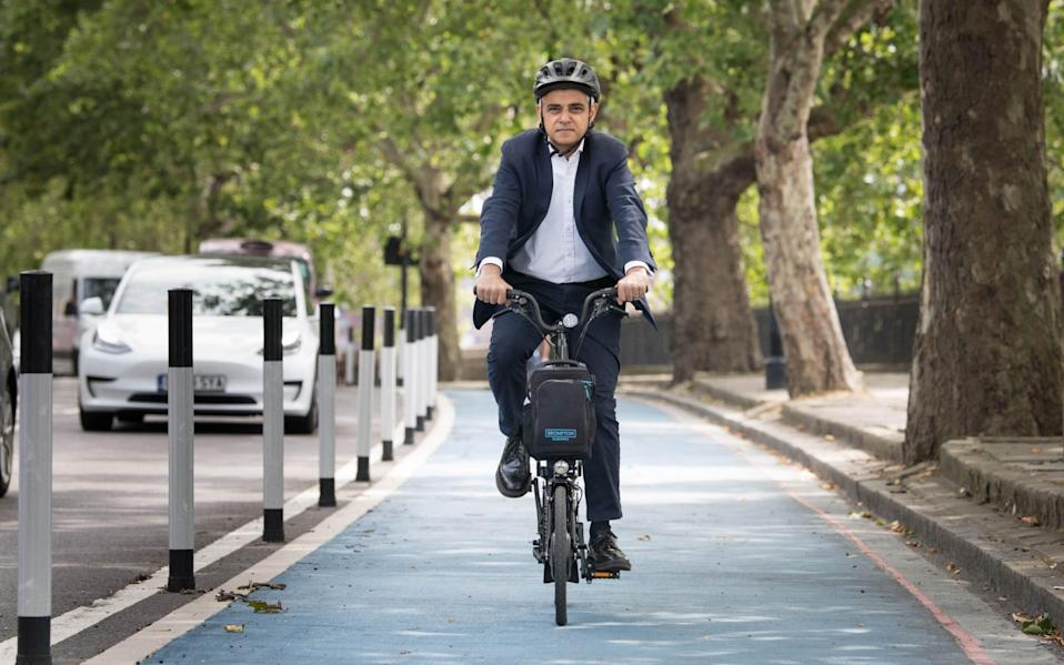 Mayor of London Sadiq Khan tries out a new Streetspace protected cycle lane in London - PA