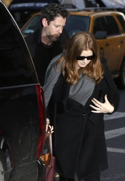 Oscar-nominated actress Amy Adams and her fiancé Darren Le Gallo arrive at a wake for actor Philip Seymour Hoffman at the Frank E. Campbell Funeral Home on Manhattan's Upper East Side, Thursday, Feb. 6, 2014, in New York. Hoffman died Sunday of a suspected drug overdose in his New York apartment. (AP Photo/Kathy Willens)