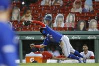 Toronto Blue Jays' Vladimir Guerrero Jr. can not make the play on the pop foul by Boston Red Sox's Xander Bogaerts during the seventh inning of a baseball game, Friday, Aug. 7, 2020, in Boston. (AP Photo/Michael Dwyer)
