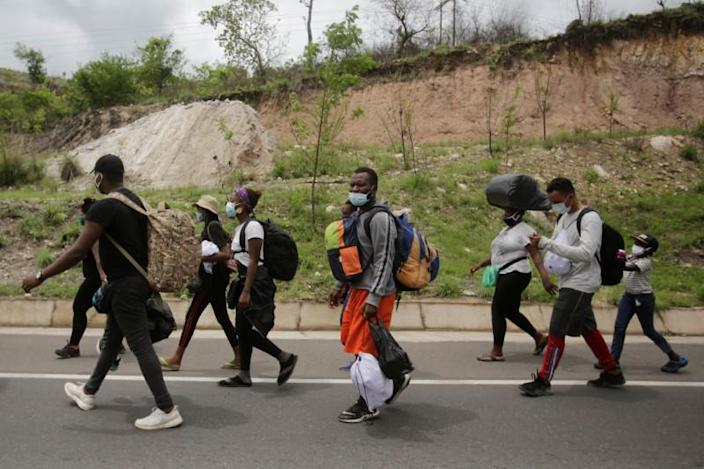 African, Cuban and Haitian migrants, which are stranded in Honduras after borders were closed due to the coronavirus disease (COVID-19) outbreak, trek northward in an attempt to reach the United States, in Choluteca