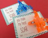 "<p>Your child's friends will be flying high when they receive these fun ""you make my heart soar"" Valentines, complete with little toy airplanes attached. A touch of hot glue works for attaching the plane. </p><p><strong>See more at <a href=""https://simplydesigning.porch.com/you-make-my-heart-soar-valentine-free/"" rel=""nofollow noopener"" target=""_blank"" data-ylk=""slk:Simply Designing"" class=""link rapid-noclick-resp"">Simply Designing</a>. </strong></p><p><a class=""link rapid-noclick-resp"" href=""https://go.redirectingat.com?id=74968X1596630&url=https%3A%2F%2Fwww.walmart.com%2Fip%2FParty-Favors-For-Kids-Bulk-Toys-72-Pack-Of-Airplane-Gliders-Individually-Wrapped-Flying-Paper-Planes-Assorted-Designs-Rewards-And-Prizes-Pinata-Fille%2F883755084&sref=https%3A%2F%2Fwww.thepioneerwoman.com%2Fhome-lifestyle%2Fcrafts-diy%2Fg35084525%2Fdiy-valentines-day-cards%2F"" rel=""nofollow noopener"" target=""_blank"" data-ylk=""slk:SHOP TOY PLANES"">SHOP TOY PLANES</a></p>"