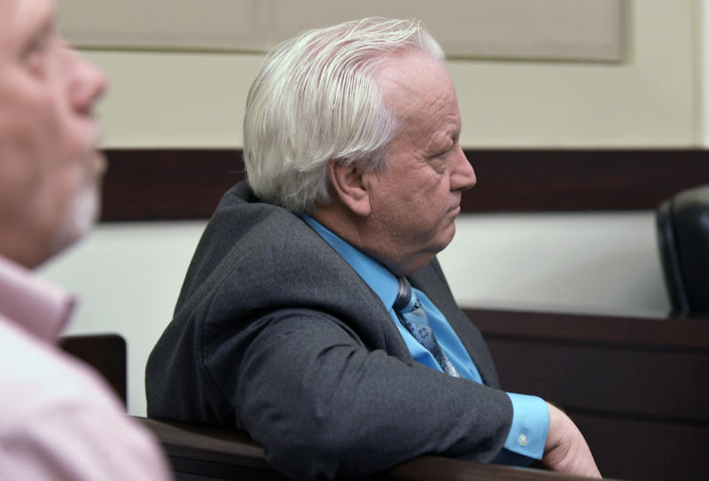 Minister Joey Spann listens as Emanuel Samson testifies during his own trial Wednesday, May 22, 2019, in Nashville, Tenn. Samson is accused of fatally shooting a woman and wounding seven people at a Nashville church in 2017. Prosecutors have said they're seeking life without parole for Samson. Spann was injured during the shooting. (Shelley Mays/The Tennessean via AP, Pool)