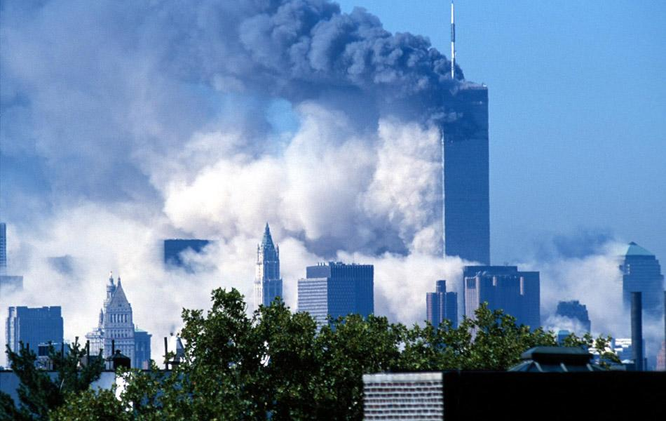 Two commercial jet liners crash into the World Trade Center, consequently causing both towers to implode and fall (3 of 6) (Photo by James Devaney/WireImage)