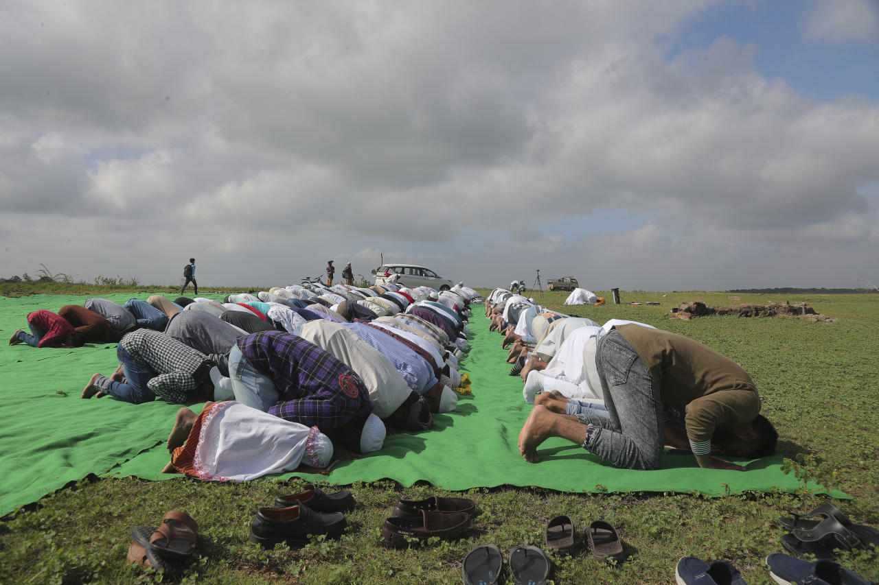 """Indian Muslims offer """"Namaz-e-Istasqa"""" a special prayer for rains at Himayat Sagar Lake on the outskirts of Hyderabad, India, Sunday, July 21, 2019. Muslims believe Namaz-e-Istasqa was offered by Prophet Mohammed seeking the almighty's intervention to ensure rains. (AP Photo/Mahesh Kumar A.)"""