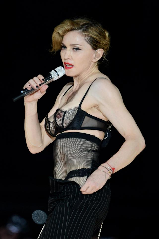 <p>The singer freed the nipple once again during her 'MDNA' tour, pairing a sheer bra with a pair of trousers – that she later removed. <em>[Photo: Getty]</em> </p>