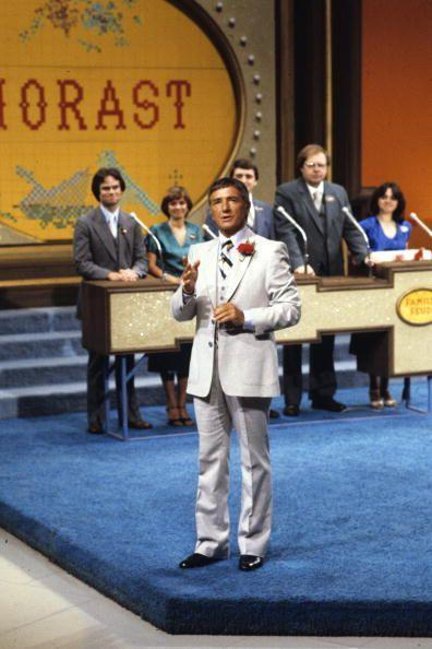 <p><em>Family Feud </em>started airing in 1976 with Richard Dawson as the host. The show brings families from around the country to answer popular survey questions. Dawson was also well known as an actor on <em>Hogan's Heroes. </em>Future seasons were hosted in daytime and primetime by Ray Combs, Louie Anderson, Richard Karn and John O'Hurley.</p>