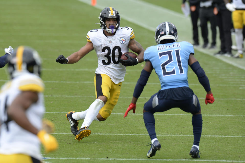 Pittsburgh Steelers running back James Conner (30) carries the ball against Tennessee Titans cornerback Malcolm Butler (21) in the first half of an NFL football game Sunday, Oct. 25, 2020, in Nashville, Tenn. (AP Photo/Mark Zaleski)
