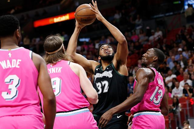 MIAMI, FL - DECEMBER 30: Karl-Anthony Towns #32 of the Minnesota Timberwolves attempts a layup against the Miami Heat during the first half at American Airlines Arena on December 30, 2018 in Miami, Florida. (Photo by Michael Reaves/Getty Images)