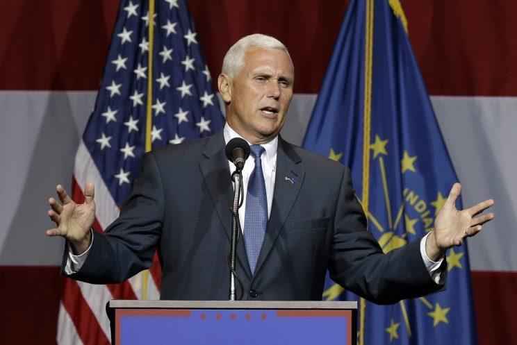 Donald Trump announced on Friday that Indiana Gov. Mike Pence, shown here at a Trump rally earlier this week, is his vice presidential pick. (Michael Conroy/AP)