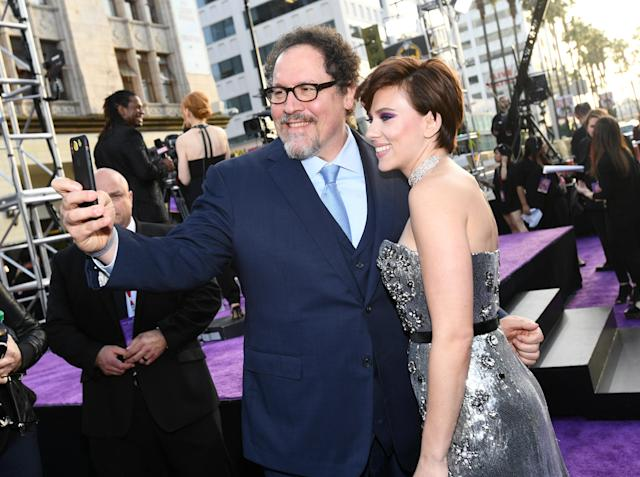 <p>Johansson also cheesed with Favreau, who launched the MCU with <em>Iron Man</em> in 2008. He is an executive producer on this one. (Photo: Emma McIntyre/Getty Images) </p>
