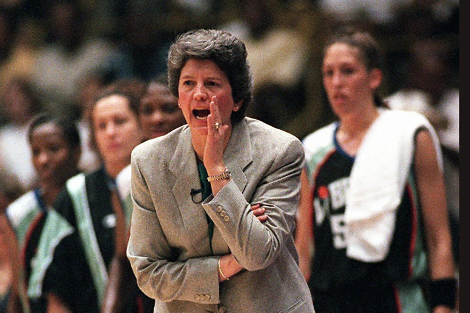 FILE - This is a June 21, 1997, file photo showing New York Liberty coach Nancy Darsch yelling instructions to her players during the inaugural WNBA basketball game, against the Los Angeles Sparks in Inglewood, Calif. The Liberty defeated the Sparks, 67-57. Darsch, who guided the Ohio State women's basketball team to the 1993 title game and went on to coach in the WNBA, died Monday, Nov. 2, 2020, in her hometown of Plymouth, Massachusetts. She was 68.(AP photo/Kevork Djansezian, FIler)