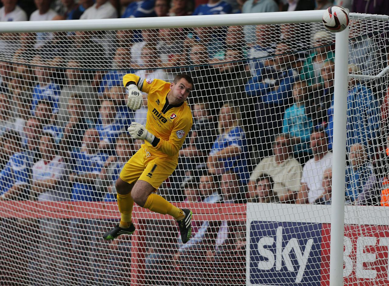 Cheltenham Town goalkeeper Scott Brown makes a save during the Sky Bet Football League Two match at the Abbey Business Stadium, Cheltenham.