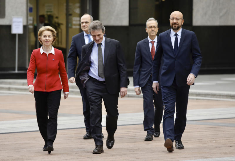 From left, European Commission President Ursula von der Leyen, European Parliament President David Sassoli and European Council President Charles Michel walk across the esplanade as they arrive for a media conference outside of the Parlamentarium in Brussels, Friday, Jan. 31, 2020. The U.K. is due to leave the EU on Friday the first nation in the bloc to do so. (AP Photo/Olivier Matthys)