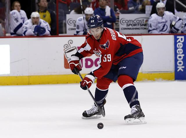 Washington Capitals defenseman Julien Brouillette (59) skates with the puck in the second period of an NHL hockey game against the Tampa Bay Lightning, Sunday, April 13, 2014, in Washington. (AP Photo/Alex Brandon)