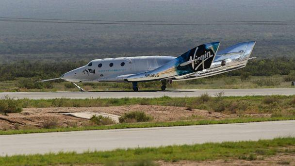 PHOTO: The Virgin Galactic SpaceShipTwo space plane Unity returns to earth after the mothership separated at Spaceport America, near Truth and Consequences, New Mexico on July 11, 2021. (Patrick T. Fallon/AFP via Getty Images)