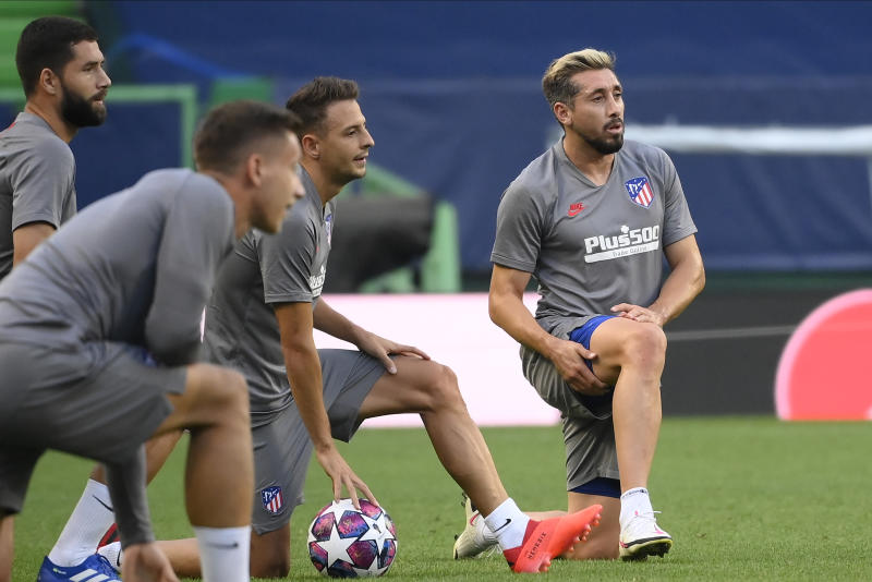 Atletico Madrid's Hector Herrera, right, takes part with his teammates during a training session at the Jose Alvalade stadium in Lisbon, Wednesday Aug. 12, 2020. Atletico Madrid will play Leipzig in a Champions League quarterfinals soccer match on Thursday. (Lluis Gene/Pool via AP)