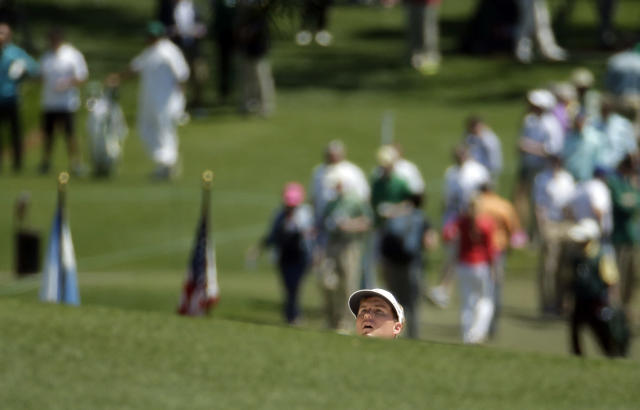 Russell Henley watches his shot out of a bunker on the first hole during the first round of the Masters golf tournament Thursday, April 10, 2014, in Augusta, Ga. (AP Photo/Charlie Riedel)