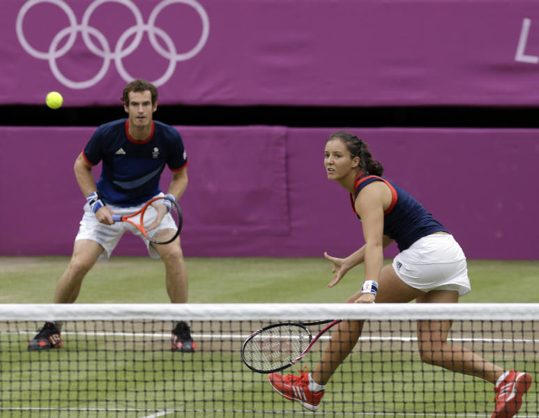 Andy Murray, left, and Laura Robson of Great Britain compete against Lleyton Hewitt and Samantha Stosur of Australia in mixed doubles at the All England Lawn Tennis Club in Wimbledon, London at the 2012 Summer Olympics, Saturday, Aug. 4, 2012. (AP Photo/Elise Amendola)