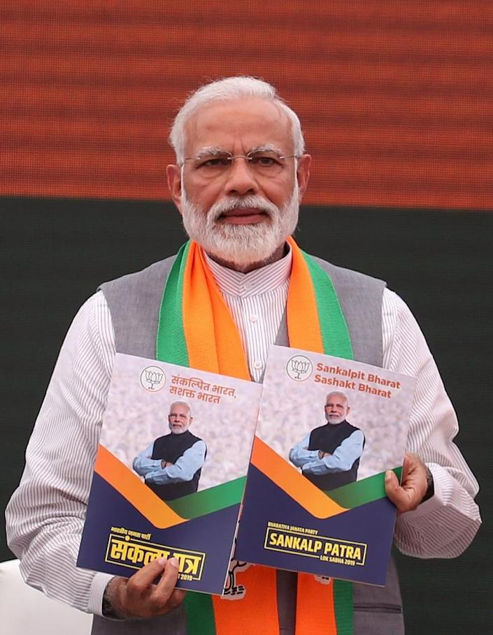 Prime Minister Narendra Modi has made it easier for foreign firms to do business in India, and carried out the biggest tax reform since independence (AFP Photo/STR)
