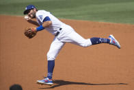 Los Angeles Dodgers second baseman Chris Taylor fields a ground ball during the second inning of a baseball game against the Los Angeles Angels in Los Angeles, Sunday, Sept. 27, 2020. (AP Photo/Kyusung Gong)