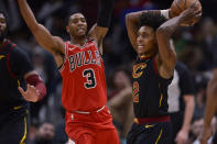 Cleveland Cavaliers' Collin Sexton, (2) looks to pass the ball as Chicago Bulls' Shaquille Harrison (3) defends during the second half of an NBA basketball game Tuesday, March 10, 2020, in Chicago. (AP Photo/Paul Beaty)