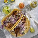 <p>Instead of deep-frying the fish for these fish tacos, we coat the fish with a flavor-packed chile rub and grill it instead. Make sure the fillets are no more than 1/2 to 3/4 inch thick so they cook quickly. Sometimes flipping fish on the grill can be tricky since the fish can stick to the grill or fall apart. The solution is to invest in a grill basket that easily holds 4 to 6 fish fillets and secures the fish in the basket for easy flipping. If you don't have a grilling basket, make sure the grill is hot and well oiled before adding the fish.</p>