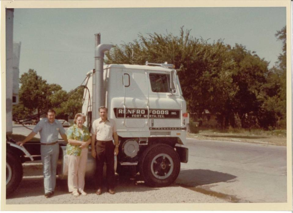 Jack Renfro (left), Arthurine Renfro (middle) and Bill Renfro (right) stand outside of a Mrs. Renfro's big rig. Arthurine and her husband, George Renfro, started the company out of their garage in 1940.