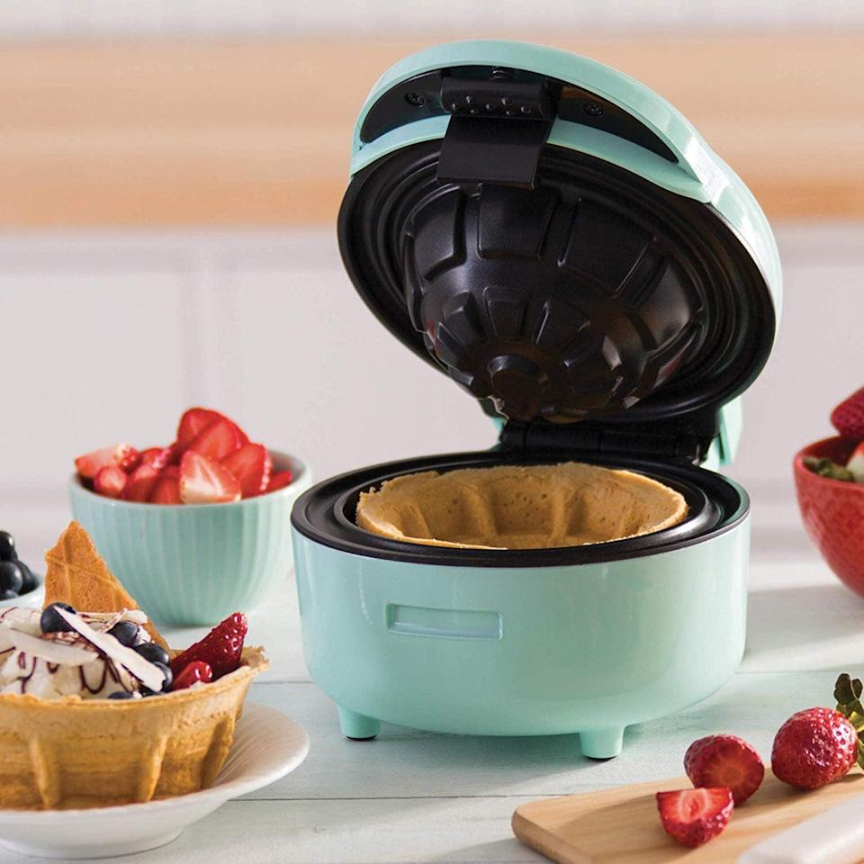 <p>If she has a sweet tooth, she'll be excited to use this <span>Dash Waffle Bowl Maker</span> ($30).</p>