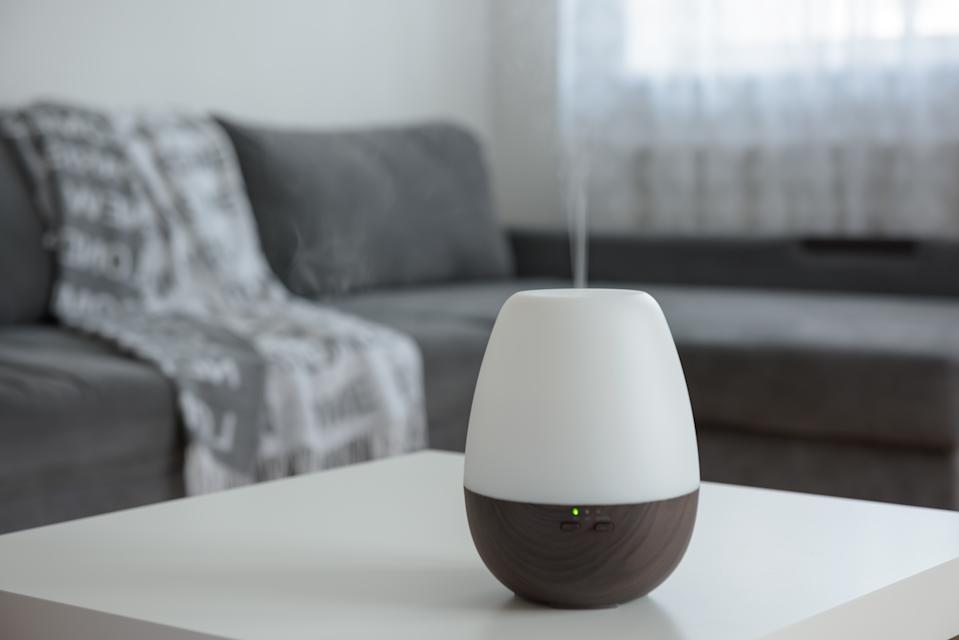 Essential Oil Diffusers on a white table on the background of the interior.