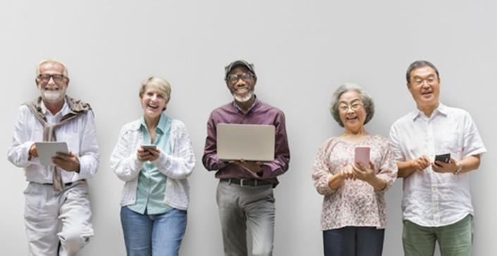 """<span class=""""caption"""">People can use digital devices while standing to minimize the amount of time they spend sitting.</span> <span class=""""attribution""""><a class=""""link rapid-noclick-resp"""" href=""""https://www.shutterstock.com/image-photo/group-senior-retirement-using-digital-lifestyle-497558443?src=9LGPLJlsMF6of6h5D7AtAw-1-36"""" rel=""""nofollow noopener"""" target=""""_blank"""" data-ylk=""""slk:Rawpixel.com/Shutterstock.com"""">Rawpixel.com/Shutterstock.com</a></span>"""
