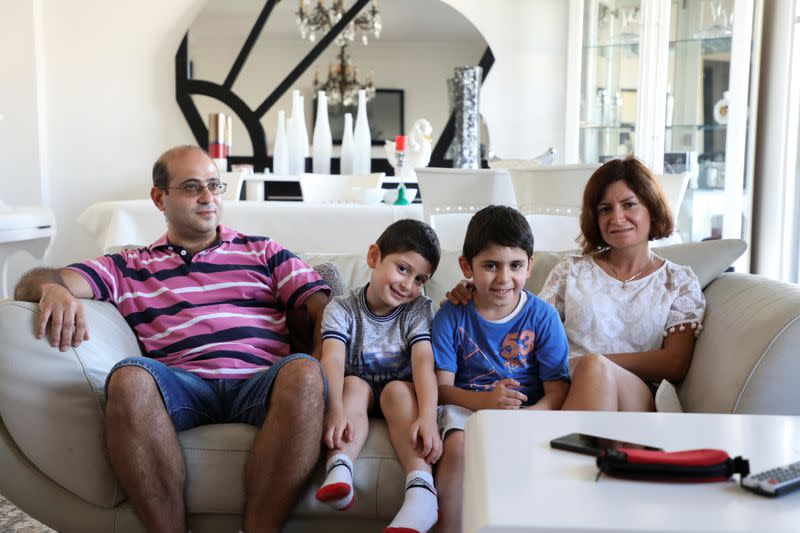 Nadim Srour, a 43-year-old who returned from the Gulf, is pictured with his wife and sons in Beirut