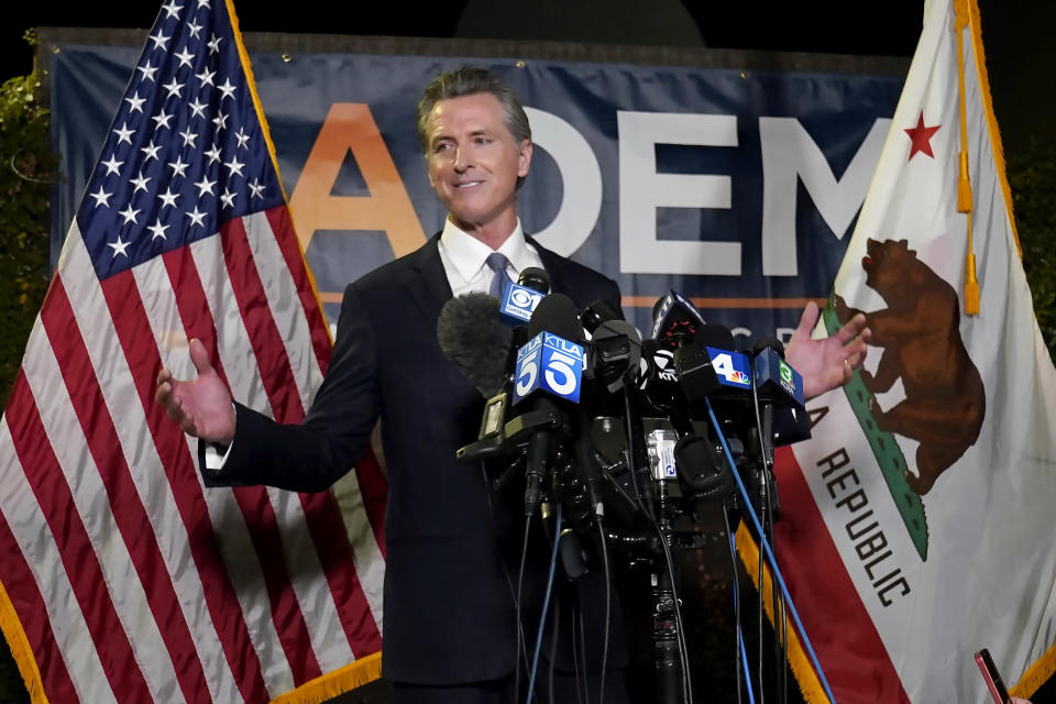 FILE - In this Sept. 14, 2021, file photo, California Gov. Gavin Newsom addresses reporters after beating back the recall attempt that aimed to remove him from office, in Sacramento, Calif. After surviving the attempted recall Newsom signed into law 92% of the bills lawmakers sent him at the end of the years legislative session that ended Sept. 10. (AP Photo/Rich Pedroncelli, File)