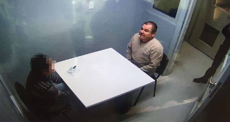 """Joaquin Guzman Loera aka """"El Chapo"""" Guzman (R) sitting in a chair as he is extradited to the United States , in an unknowen location on January 20, 2017"""