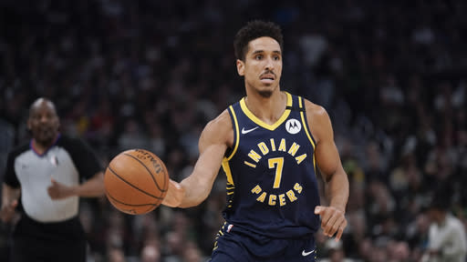 Indiana Pacers' Malcolm Brogdon dribbles during the second half of an NBA basketball game against the Milwaukee Bucks Wednesday, March 4, 2020, in Milwaukee. The Bucks won 119-100. (AP Photo/Morry Gash)