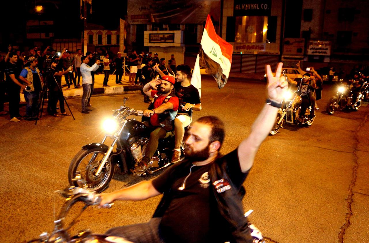 <p>People celebrate in Baghdadafter Iraqi special forces entered the center of Fallujah after fighting Islamic State group militants. (Photo:Hadi Mizban/Associated Press) </p>