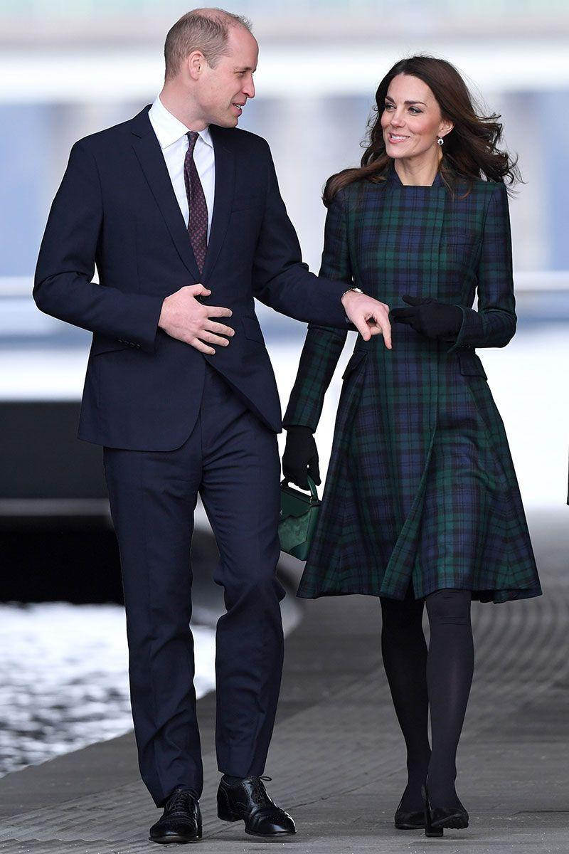 <p>Kate and Prince William were in Dundee to open Scotland's first design museum, the V&A, when the Duchess wore one of her favourite tartan coats. The design is a custom one from Alexander McQueen, and she added a green suede Manu Atelier bag. </p>