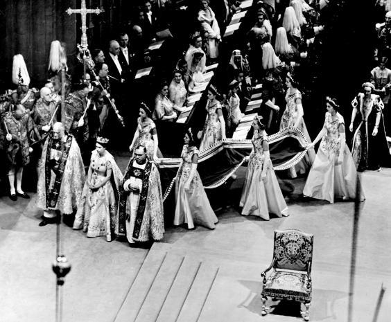 The Queen arrives at Westminster Abbey with her six Maids-of-Honour. She walks beside the Bishop of Durham (on her right) and the Bishop of Bath (PA/PA Wire)