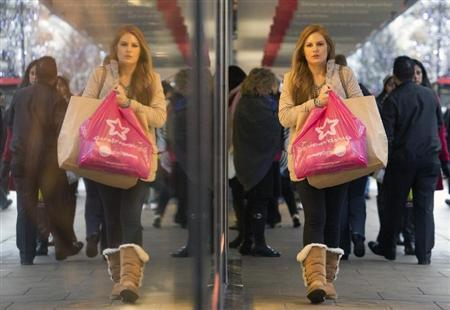 Pedestrians walk past a store on Oxford Street in central London