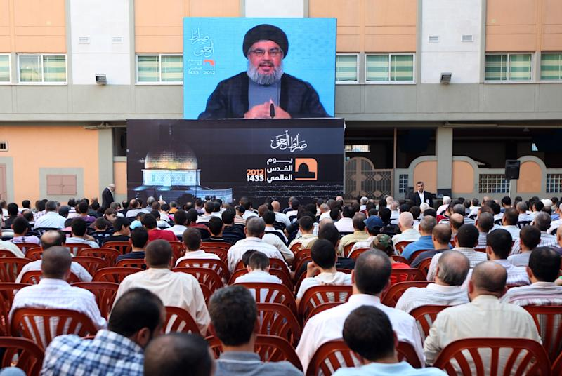 Hezbollah leader Sheikh Hassan Nasrallah speaks through a video link on the occasion of Jerusalem Day in the southern suburb of Beirut, Lebanon, Friday, Aug 17, 2012. Nasrallah warned Israel that any aggression against Lebanon would be extremely costly and said Hezbollah can transform the lives of millions of Zionists in all of Israel to hell. (AP Photo/Bilal Hussein)
