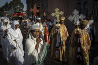 Priests from the Ethiopian Orthodox Tewahedo Church lead the procession during a Sunday morning service at the Church of St. Mary in Mekele, in the Tigray region of northern Ethiopia Sunday, May 9, 2021. The head of the Ethiopian Orthodox Church, Patriarch Abune Mathias, in a video shot last month on a mobile phone and carried out of Ethiopia, sharply criticized Ethiopia's actions in the conflict in the country's Tigray region. (AP Photo/Ben Curtis)
