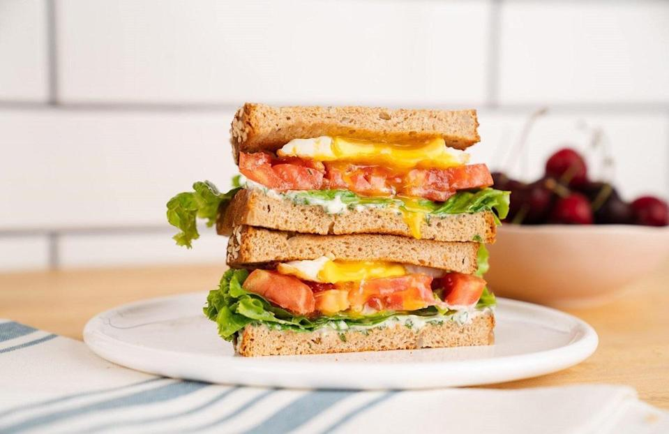 """<p>An ELT is like a BLT, but with one obvious caveat — it includes eggs instead of bacon. It's a welcome substitute if you're vegetarian or someone that hates dealing with bacon grease. The <a href=""""https://www.thedailymeal.com/cook/foolproof-guide-cooking-eggs-scrambled-fried-hard-boiled-and-more-slideshow?referrer=yahoo&category=beauty_food&include_utm=1&utm_medium=referral&utm_source=yahoo&utm_campaign=feed"""" rel=""""nofollow noopener"""" target=""""_blank"""" data-ylk=""""slk:perfectly cooked egg with a runny yolk"""" class=""""link rapid-noclick-resp"""">perfectly cooked egg with a runny yolk</a> gives the sandwich such a rich, buttery appeal that you won't even miss the B!</p> <p><a href=""""https://www.thedailymeal.com/recipes/elt-sandwich?referrer=yahoo&category=beauty_food&include_utm=1&utm_medium=referral&utm_source=yahoo&utm_campaign=feed"""" rel=""""nofollow noopener"""" target=""""_blank"""" data-ylk=""""slk:For the ELT Sandwiches With Basil Mayonnaise recipe, click here."""" class=""""link rapid-noclick-resp"""">For the ELT Sandwiches With Basil Mayonnaise recipe, click here.</a></p>"""