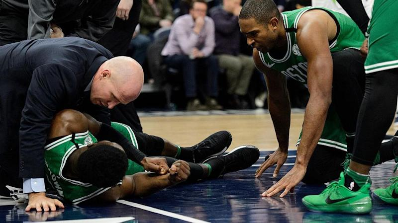 Staff attend Brown after his fall. Pic: Getty