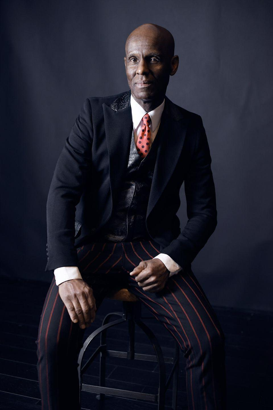 "<p>Daniel Day, who goes by Dapper Dan, is a Harlem couturier known as the king of ""knockoffs."" He made a name for himself in the late '80s when he opened his renowned Dapper Dan's Boutique in Harlem. A self taught tailor with a unique style, Dapper Dan <a href=""https://www.businessoffashion.com/community/people/dapper-dan"" rel=""nofollow noopener"" target=""_blank"" data-ylk=""slk:provided rap culture with its signature style"" class=""link rapid-noclick-resp"">provided rap culture with its signature style</a>, reworking traditional luxury-house products to outfit a slew of emerging hip-hop stars and athletes, including the likes of LL Cool J, James Jackson, and Floyd Mayweather. Unfortunately with recognition came lawsuits as luxury brands claimed he violated copyright laws by using their logos. In 1992, Fendi conducted a raid on his boutique, forcing Dapper Dan to close his doors. Over a decade later Dan had an unexpected comeback when Gucci's cruise show in 2017<a href=""https://www.businessoffashion.com/community/people/dapper-dan"" rel=""nofollow noopener"" target=""_blank"" data-ylk=""slk:featured a balloon-sleeved mink bomber jacket"" class=""link rapid-noclick-resp""> featured a balloon-sleeved mink bomber jacket</a> very similar to Dan's iconic 1989 Louis Vuitton version. Just as Dan fans were screaming ripoff, Gucci invited Dan to create a capsule collection inspired by his archive. In 2018, along with Gucci, Dan opened an invitation-only atelier in Harlem. This move solidified Dan as the first true luxury brand out of Harlem.<br> </p>"