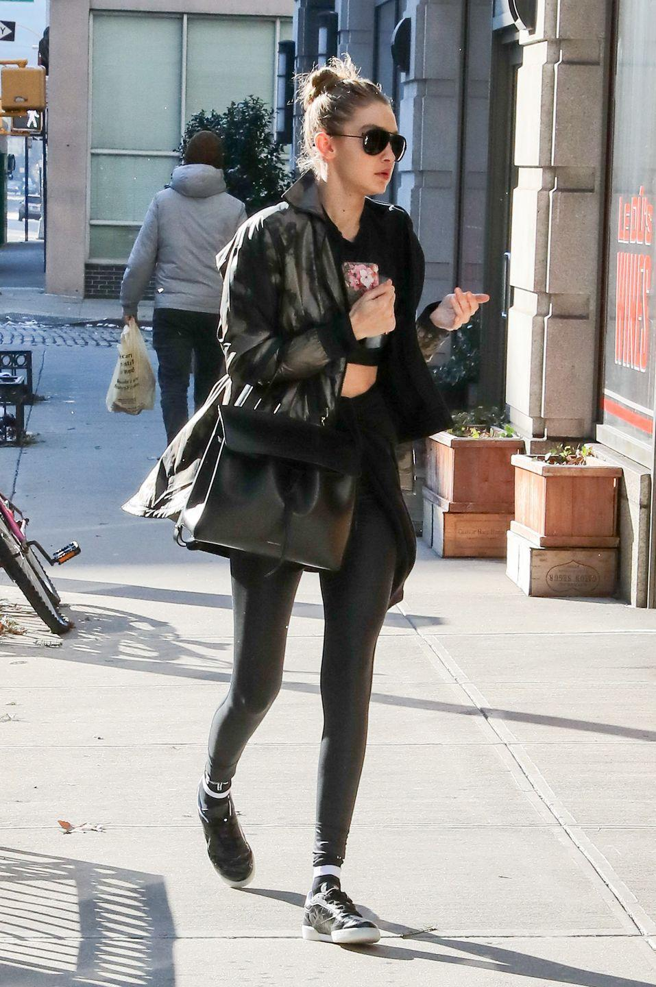 <p>The model stepped out in NYC wearing simple black leggings and a basic black puffy coat. </p>