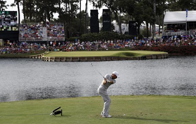 Sergio Garcia, of Spain, hits from the 17th tee during the third round of The Players championship golf tournament at TPC Sawgrass, Saturday, May 10, 2014, in Ponte Vedra Beach, Fla. (AP Photo/Lynne Sladky)