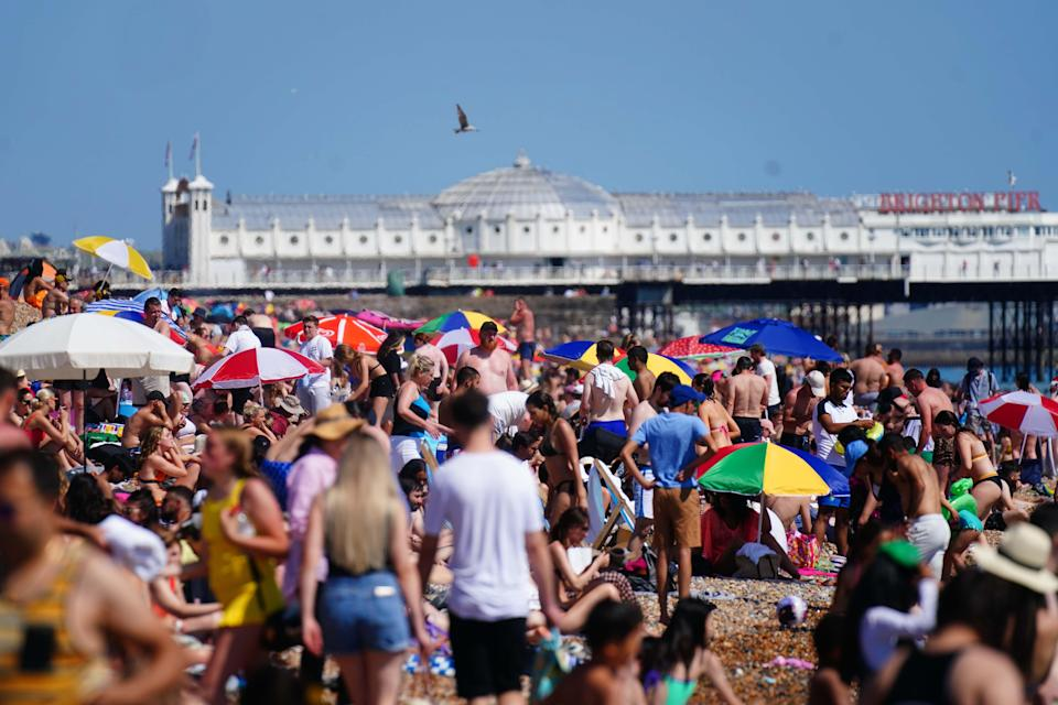People enjoy the hot weather in Brighton (Victoria Jones/PA) (PA Wire)