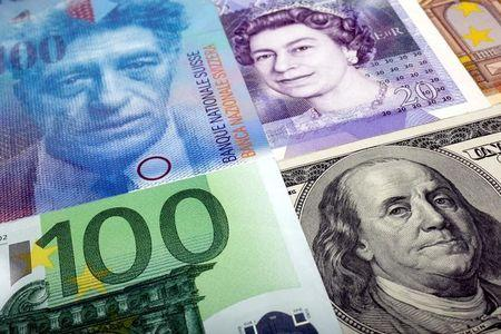 FILE PHOTO - A picture illustration of  U.S. dollar, Swiss franc, British pound and Euro bank notes