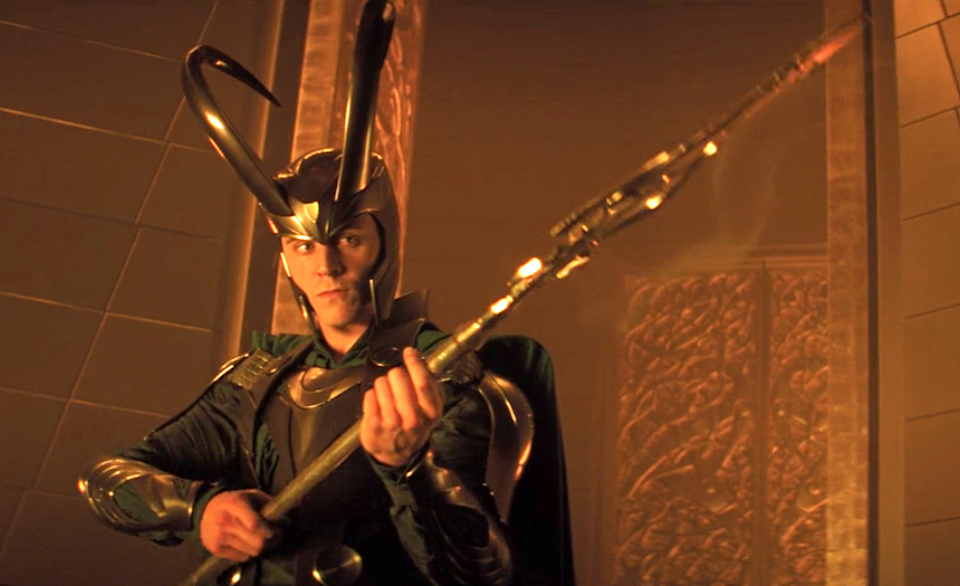 Loki wearing his massive helmet with huge curved horns bending up and back over his head