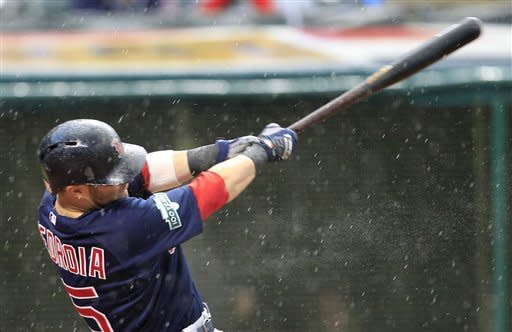 Boston Red Sox's Dustin Pedroia hits an RBI single off Cleveland Indians starting pitcher Chris Seddon in the fourth inning of a baseball game, Friday, Aug. 10, 2012, in Cleveland. Mike Aviles scored. (AP Photo/Tony Dejak)