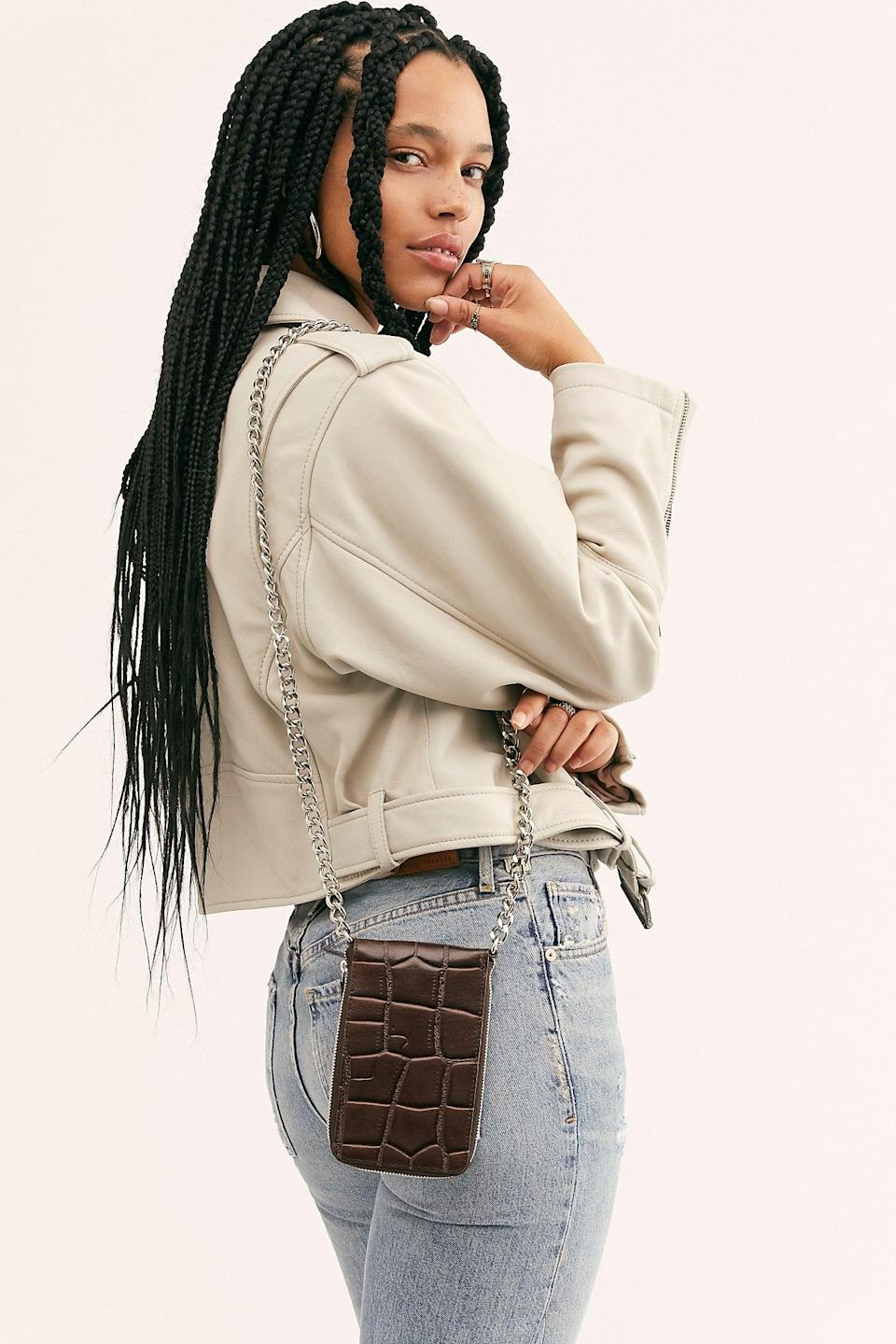 """<p>They can rock this <a href=""""https://www.popsugar.com/buy/All-Night-Chunky-Chain-Wallet-527144?p_name=All%20Night%20Chunky%20Chain%20Wallet&retailer=freepeople.com&pid=527144&price=30&evar1=fab%3Aus&evar9=45460327&evar98=https%3A%2F%2Fwww.popsugar.com%2Ffashion%2Fphoto-gallery%2F45460327%2Fimage%2F46977994%2FAll-Night-Chunky-Chain-Wallet&list1=shopping%2Cgifts%2Cfree%20people%2Choliday%2Cgift%20guide%2Cgifts%20for%20women&prop13=api&pdata=1"""" class=""""link rapid-noclick-resp"""" rel=""""nofollow noopener"""" target=""""_blank"""" data-ylk=""""slk:All Night Chunky Chain Wallet"""">All Night Chunky Chain Wallet</a> ($30) on a night out.</p>"""